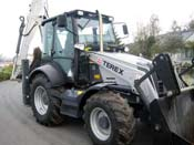 loaders TEREX 860 Elite with hydraulic hammer from City Rental Company in Russia